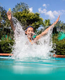 The cheerful girl jumps in the pool Royalty Free Stock Photography