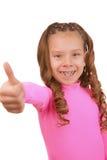Cheerful girl lifts thumb upwards Stock Image