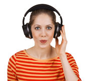 Cheerful girl listening to music on headphones Stock Photo