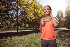 Cheerful girl listening to music before morning exercises Royalty Free Stock Photo