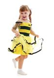 Cheerful girl in lush black and yellow striped Royalty Free Stock Photo