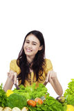 Cheerful girl making vegetable salad Stock Images