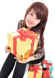 Cheerful girl with many gifts Royalty Free Stock Photography