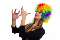 Cheerful girl and multi-colored wig Royalty Free Stock Image