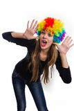 Cheerful girl and multi-colored wig Stock Image