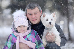 Cheerful girl with my dad and little dog Royalty Free Stock Image