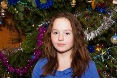Cheerful girl near the Christmas tree Christmas Stock Photo