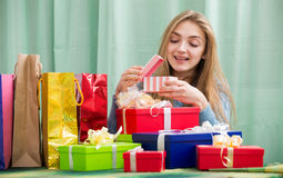 Cheerful girl opening box with gift Stock Photography
