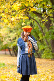Cheerful girl in orange beret Stock Images