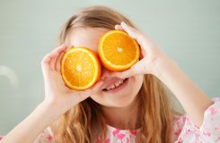 Cheerful girl with orange Royalty Free Stock Images