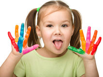 Cheerful girl with painted hands Stock Images