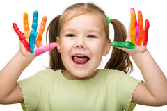 Cheerful girl with painted hands Stock Image