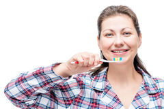 Cheerful girl in pajamas with a toothbrush in the morning Stock Photos