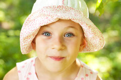 Cheerful girl in panama Stock Photos
