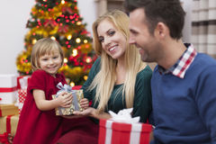 Cheerful girl with parents in Christmas time Royalty Free Stock Image