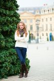 Cheerful girl on a Parisian street Royalty Free Stock Images
