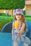 Cheerful girl peach juice drink Royalty Free Stock Photo