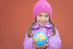 Cheerful girl in pink jacket Stock Images