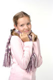 Cheerful girl in a pink jacket with a scarf. Beautiful girl with a scarf Royalty Free Stock Photography