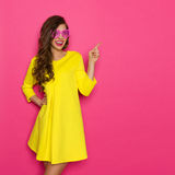 Cheerful Girl In Pink Sunglasses Pointing Royalty Free Stock Photography