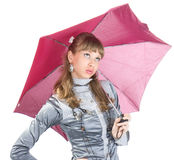 The cheerful girl   with a pink umbrella Royalty Free Stock Images
