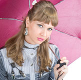 The cheerful girl   with a pink umbrella Royalty Free Stock Photos