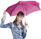 The cheerful girl   with a pink umbrella Stock Images