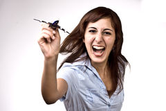Cheerful Girl With Plane. Photo Of A Cheerful Woman Launching A Miniature Plane Model Royalty Free Stock Photography
