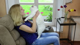 Cheerful girl play cat stock footage