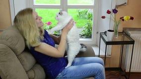 Cheerful girl play cat Stock Photo