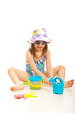 Cheerful girl playing with beach toys royalty free stock photography
