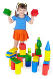 Cheerful girl playing with colored blocks. On white royalty free stock photography