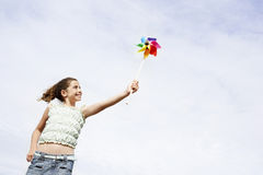 Cheerful Girl Playing With Pinwheel Royalty Free Stock Image