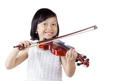 Cheerful girl playing violin in the studio Royalty Free Stock Photos
