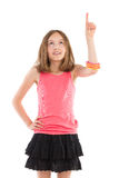 Cheerful girl pointing and looking up Royalty Free Stock Photography