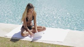 Cheerful girl in pool with laptop stock video