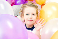 Cheerful girl posing with balloons, close-up Stock Image