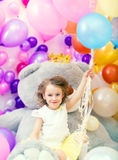 Cheerful girl posing holding bunch of balloons Royalty Free Stock Photography