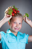 Cheerful girl posing with horns made of broccoli Royalty Free Stock Photography