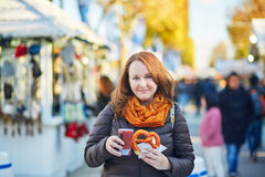 Cheerful girl with pretzel and hot wine Royalty Free Stock Image