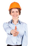 Girl in a protective helmet shows that all okay Stock Images