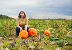 Cheerful girl on a pumpkin patch Royalty Free Stock Photography