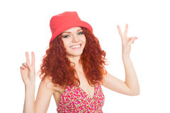 Cheerful girl with red hair wearing a hat Stock Image