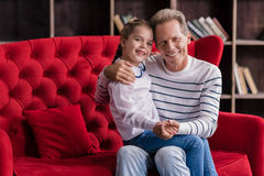 Cheerful girl resting with her grandfather Stock Images