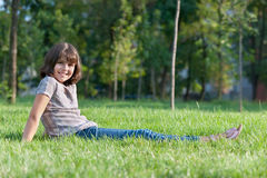 Cheerful girl resting in the park Royalty Free Stock Photos