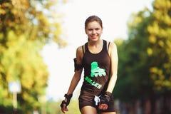 Cheerful girl on roller skates stock images