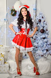 Cheerful girl in the Santa Claus hat. New Year decorations, gift. S, Christmas tree Stock Photo