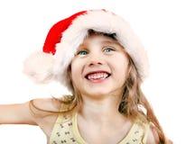 Cheerful Girl in Santa Hat Stock Photos