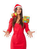Cheerful girl in a Santa's helper hat catches your Christmas gifts. Cheerful girl in red dress catches your Christmas gifts royalty free stock photo