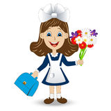 Cheerful girl in school uniform with a bouquet of flowers Stock Photography